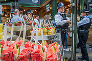Authorities remain vigilant with Police and Paramedics highly visible - The market reopening is signified by the ringing of the bell and is attended by Mayor Sadiq Khan. Tourists and locals soon flood back to bring the area back to life.