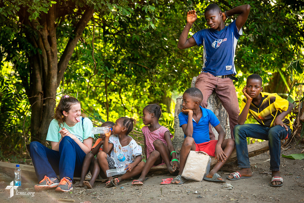 Hayden Rensner, a student at Concordia University, Nebraska, plays with children following the second day of the LCMS Mercy Medical Team on Tuesday, May 8, 2018, in the Yardu village outside Koidu, Sierra Leone, West Africa. LCMS Communications/Erik M. Lunsford