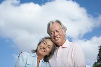 Portrait of senior couple against sky smiling