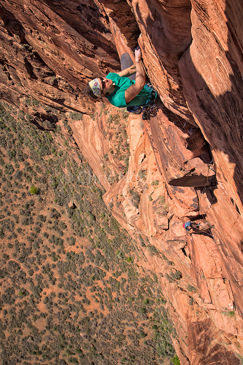 "Madaleine Sorkin free climbing the ""Sharper Crack,"" (11a )the final pitch of ""Sheer Lunacy"" in Zion National Park"