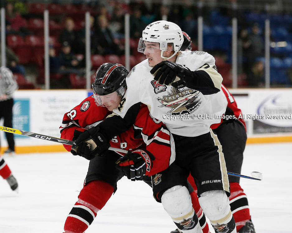 TRENTON, ON - MAR 21,  2017: Ontario Junior Hockey League, playoff game between the Trenton Golden Hawks and the Stouffville Spirit., Brad Yowart #8 of the Stouffville Spirit and Chris Sekelyk #24 of the Trenton Golden Hawks battle during the third period<br /> (Photo by Amy Deroche / OJHL Images)
