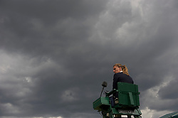 LONDON, ENGLAND - Friday, June 24, 2011: An umpire under heavy clouds  during the Ladies' Singles 3rd Round match on day five of the Wimbledon Lawn Tennis Championships at the All England Lawn Tennis and Croquet Club. (Pic by David Rawcliffe/Propaganda)