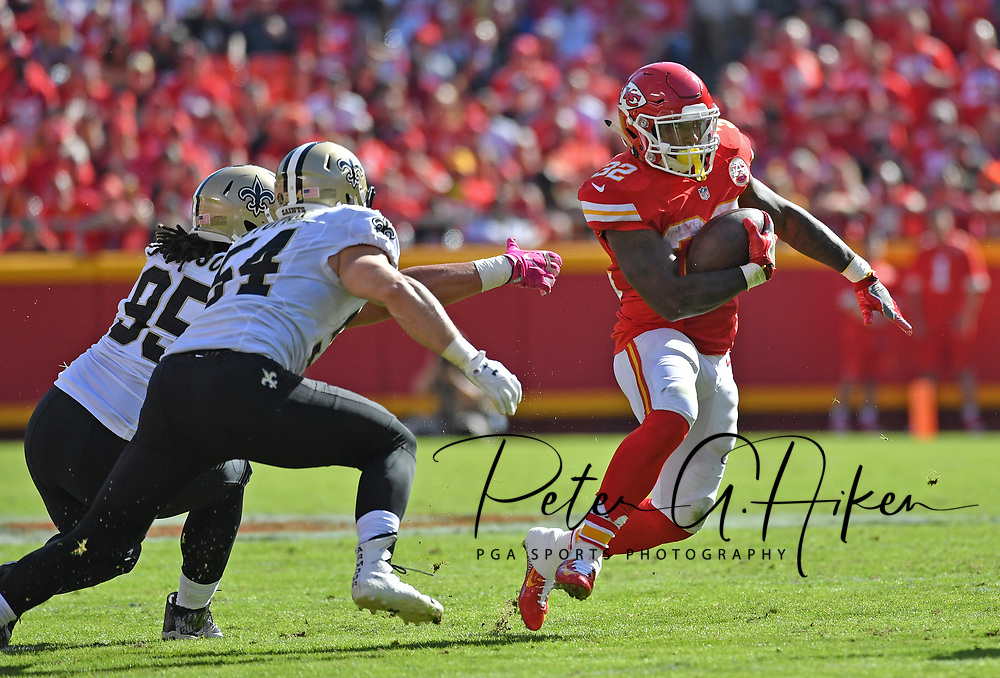 KANSAS CITY, MO - OCTOBER 23:  Running back Spencer Ware #32 of the Kansas City Chiefs rushes past defenders Nate Stupar #54 and Tyeler Davison #95 of the New Orleans Saints during the second half on October 23, 2016 at Arrowhead Stadium in Kansas City, Missouri.  (Photo by Peter G. Aiken/Getty Images) *** Local Caption *** Spencer Ware;Tyeler Davison