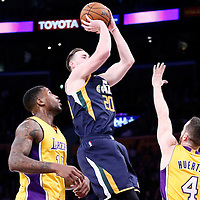 05 December 2016: Utah Jazz forward Gordon Hayward (20) takes a jump shot over Los Angeles Lakers guard Marcelo Huertas (4) and past Los Angeles Lakers forward Thomas Robinson (15) during the Utah Jazz 107-101 victory over the Los Angeles Lakers, at the Staples Center, Los Angeles, California, USA.