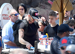 EXCLUSIVE: *NO WEB UNTIL 1030PM GMT 16TH APRIL* David and Victoria Beckham take their kids on a fun day out at Disneyland. The happy couple were seen riding rollercoasters, eating snacks and having fun in the California sun. 14 Apr 2018 Pictured: David Beckham, Victoria Beckham, harper Beckham, Cruz Beckham, Romeo Beckham. Photo credit: Snorlax / MEGA TheMegaAgency.com +1 888 505 6342
