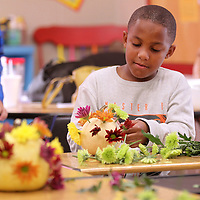 Adam Robison | BUY AT PHOTOS.DJOURNAL.COM<br /> Anderson Shoemaker, a third grade student at Lawndale Elementary School, builds his pumpkin centerpiece for Thanksgiving in Jr. Garden Club Monday after school.