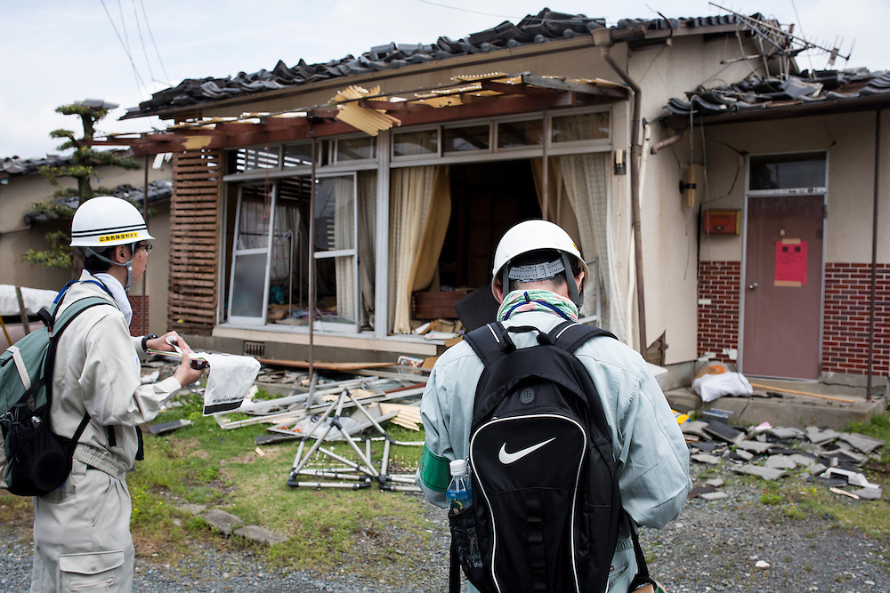 KUMAMOTO, JAPAN - APRIL 22:  Japan's Emergency Risk Discriminators stuck a notice 'unsafe' to the property on April 22, 2016 in Mashiki town, Kumamoto, Japan. To date 48 people are confirmed dead and more than 80,000 people have evacuated after an 6.5 earthquake on Thursday night and a stronger 7.3 quake on Saturday morning struck the Kyushu Island in western Japan.<br /> <br /> Photo: Richard Atrero de Guzman