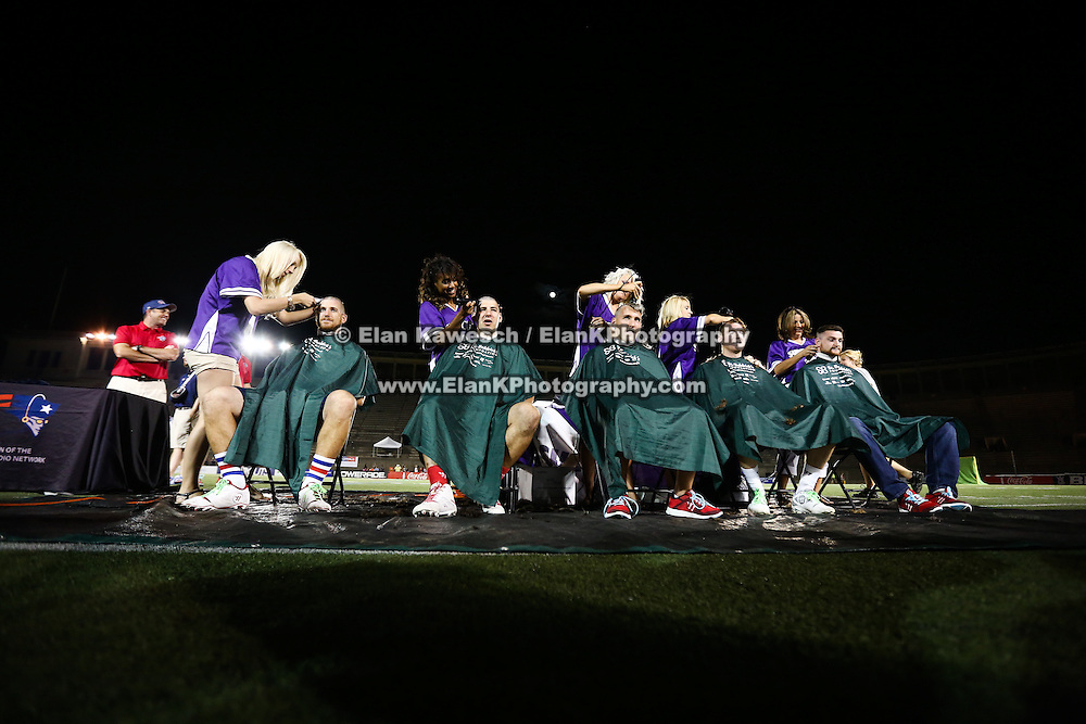 Members of the Boston Cannons get their heads shaved for charity following the game at Harvard Stadium on August 9, 2014 in Boston, Massachusetts. (Photo by Elan Kawesch)