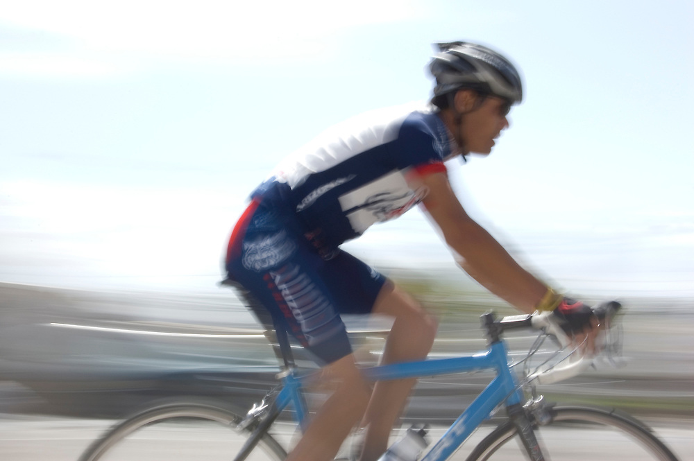 Blurry bicycle racer at 2009 UA Criterium on the University of Arizona campus. Bike-tography by Martha Retallick.