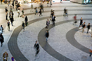 business people and shoppers crossing a square  in Yurakucho district of Tokyo