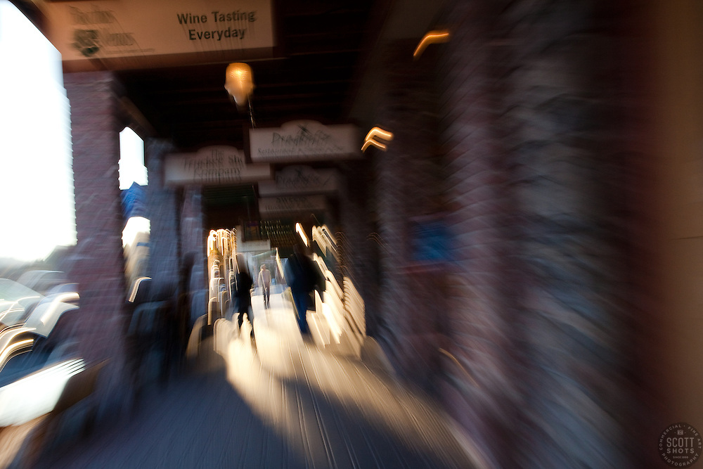 """""""Wine Tasting Every Day"""" - A """"drunken"""" scene in downtown Truckee, CA. The look was achieved by zooming the lens while shooting the photo."""