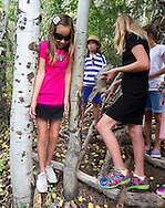 Natasha and Mary join their friends in the woods surrounding the Journey's School during the annual Teton Science School Auction.