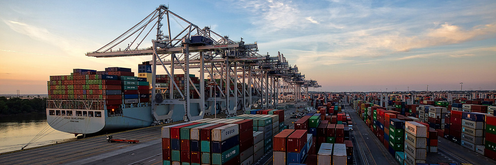 Six Georgia Ports Authority shop to neo-panamax shore cranes work the container ship Cosco Development docks at the Port of Savannah, Friday, May 12, 2017, in Savannah, Ga. At 1,201 feet long and 158 feet wide, the Cosco Development is the largest vessel ever to call on the U.S. East Coast. (AP Photo/Georgia Port Authority, Stephen Morton)