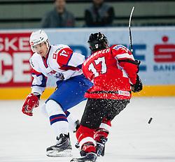 Ziga Pavlin of Slovenia vs Michael Grabner of Austria during ice-hockey match between Austria and Slovenia at IIHF World Championship DIV. I Group A Slovenia 2012, on April 21, 2012 at SRC Stozice, Ljubljana, Slovenia. (Photo By Matic Klansek Velej / Sportida.com)