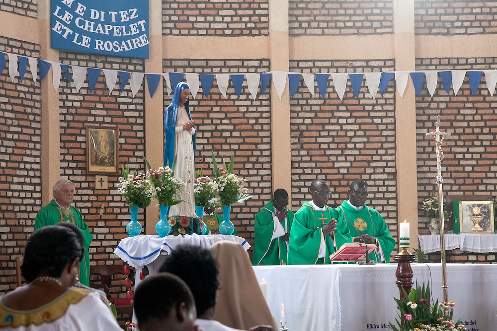 Mass at The Shrine of Our Lady of Sorrows in Kibeho, Rwanda, on Sunday, October 26, 2014. The banner reads &quot;Meditate the Rosary,&quot; is a reference to one of the messages from the Virgin Mary, who appeared here in 1981 to three young women, one of whom still lives near the church grounds. This is the only sanctioned Marian sanctuary in Africa. <br />  <br /> Kibeho's overseers and the Rwandan government hope this place will become a top tourism site. <br /> <br /> Photo by Laura Elizabeth Pohl