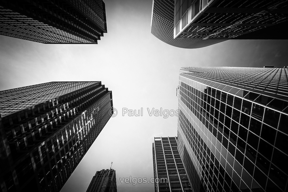 Black and white Chicago skyscraper office buildings looking upward toward the sky.