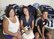 Renee Climmons, with Brittnay and Devon sit with some of their sports equipment, Saturday, August 11, 2007.