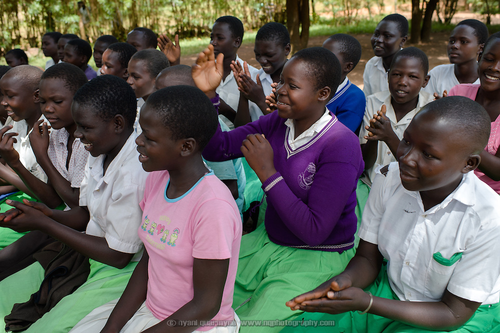 Margaret Kigeni (centre) during a talk about a range of hygiene and health issues, including menstrual hygiene, at Achilet Primary School near Tororo in Eastern Uganda on 1 August 2014. Education about menstruation is provided to both boys and girls to destigmatise it, and to improve the general level of knowledge about it in the community.