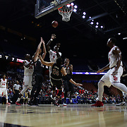 Durand Johnson, St. John's, shoots over Michael Carrera, South Carolina, during the St. John's vs South Carolina Men's College Basketball game in the Hall of Fame Shootout Tournament at Mohegan Sun Arena, Uncasville, Connecticut, USA. 22nd December 2015. Photo Tim Clayton