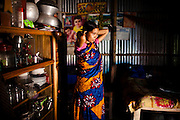 """Nargis Akhter takes care of her 7 month old son Nahid Hassan in her home compound in Gazipur village, Upazila Sreepur, Gazipur, Bangladesh on 21st September 2011. Nargis, now aged 19, was pulled our of school and wed when she was 12 years old as her family was afraid that she might become a victim of severe eve-teasing. Sad to leave school, she recalls being 'terrified, sad and uncertain' on the day of her marriage. Being married off at such a young age """"is not good for health,"""" she says. Her first baby died soon after birth and she is now raising her 2nd child. Photo by Suzanne Lee for The Guardian"""