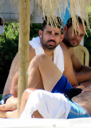 EXCLUSIVE: Diego Costa relaxes with a cold beer on the beach during his birthday weekend in Spain. Having completed a £54m return to Atletico Madrid last month, the Spain international is being worked hard by the Atleti fitness coaches after he spent his summer back in his native Brazil while in a standoff with Chelsea boss Antonio Conte. Atletico are currently under a FIFA transfer ban until January and as such, Costa cannot play for his new side until the new year. 08 Oct 2017 Pictured: Diego Costa drinking beer in the beach with friends. Photo credit: MEGA TheMegaAgency.com +1 888 505 6342
