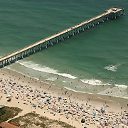 Aerial images of Johnnie Mercer's Fishing Pier in Wrightsville Beach, North Carolina. The concrete structure is one of the state's last fishing piers.