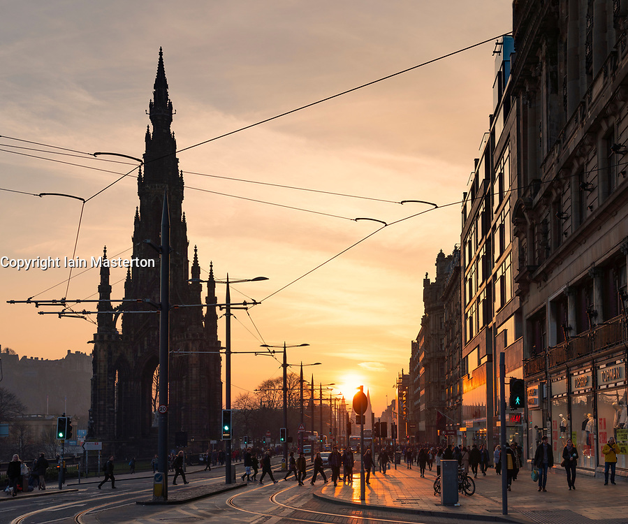 View along Princes Street in Edinburgh during sunset. Scotland, UK