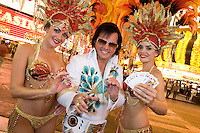 Elvis impersonator and female dancers having fun