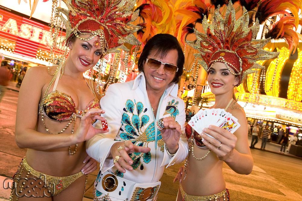 Elvis impersonator and female dancers having fun