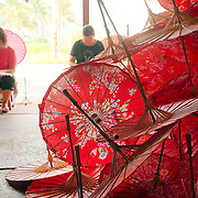 Workers making traditional cloth and bamboo umbrellas at Guangdexing Paper Umbrella Shop, Meinong Township, Kaohsiung County, Taiwan