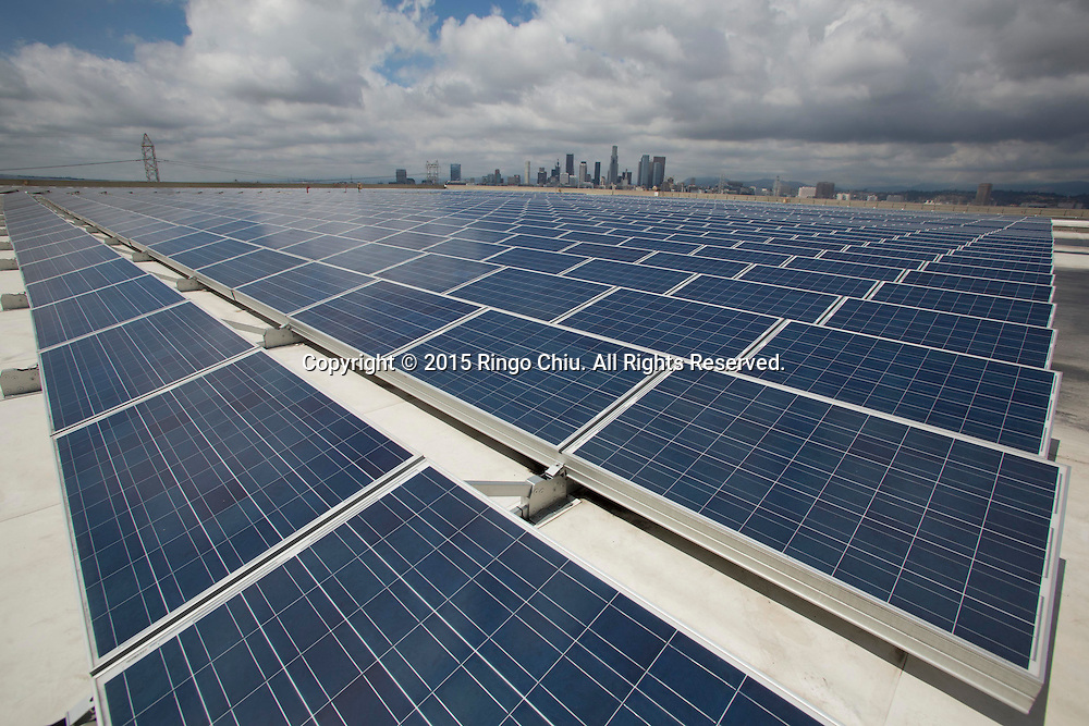 Solar panels are seen on the roof of the Dependable Logistics Services building in Los Angeles. The company is using 5,300 solar panels to produce as much as 70 percent of the energy their business uses at its 1.5-million-square-foot corporate headquarters and warehouse in Los Angeles. (Photo by Ringo Chiu/PHOTOFORMULA.com)