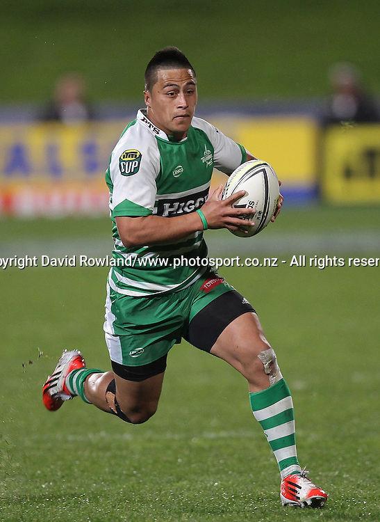 Manawatu`s Newton Tudreu makes a run in an ITM Cup Rugby Match, North Harbour v Manawatu, QBE Stadium, Auckland, New Zealand, Friday, September 12, 2014. Photo: David Rowland/Photosport