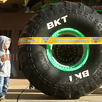 Jackson Westcott, 3, of Tupelo, walks around Grave DIgger as he looks over the Monster Truck Friday morning at the BancorpSouth Arena after receiving his ticket voucher for donating children's books during a book drive for The United Way of Northeast Mississippi.