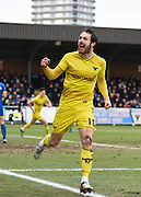 Oxford forward Danny Hylton celebrates the opening goal during the Sky Bet League 2 match between AFC Wimbledon and Oxford United at the Cherry Red Records Stadium, Kingston, England on 27 February 2016. Photo by David Charbit.