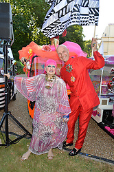ZANDRA RHODES and ANDREW LOGAN at the Quintessentially Foundation and Elephant Family 's 'Travels to My Elephant' Royal Rickshaw Auction presented by Selfridges and hosted by HRH The Prince of Wales and The Duchess of Cornwall held at Lancaster House, Cleveland Row, St.James's, London on 30th June 2015.