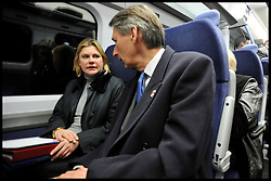 Transport Secretary Justine Greening  on a train with former Transport Secretary Philip Hammond, Monday January 9, 2012. It was announced today that Phase one of high-speed rail line gets go-ahead. Photo By Andrew Parsons/ i-Images