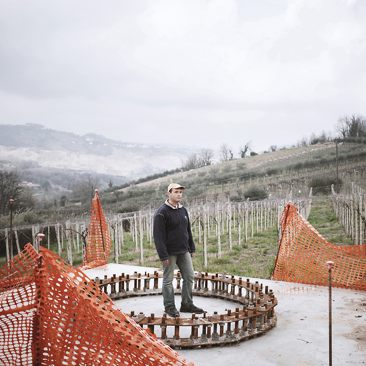 Fabio Di Tullio, a young farmer from Filetto (CH), stands on the base of one of the pillars for the new mega-power line, built in the middle of his vineyard and a dozen meters away from his house.<br />