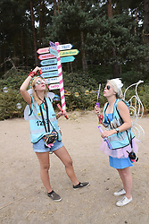 Latitude Festival, Henham Park, Suffolk, UK July 2018. Pixie helpers giving out information to festival goers