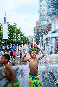 "WASHINGTON DC - June, 9:<br /> <br /> Twins Ayden and Bryce Opima, 9, from Olney  play in the fountain at the District Wharf in the Southwest Waterfront neighborhood of Washington DC, Saturday, June 9, 2018. <br /> <br /> The Wharf is DC's latest attempt to be a ""real"" city. It took multiple agencies and act of congress to get it built. Did they repeat the mistakes of urban renewal (which moved lower income people out of the neighborhood)? Yes and no. People will still be driven out, but this time around the neighborhood is integrated more.<br /> (Photo by Matt Roth for The Washington Post)"