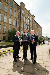 Left to right .Prof. Bob Cragan Vice Chair of the University of Huddersfield, Stefan Gabriel President of 3M new ventures and Alan Lewis CBE Chairman of Hartley Property Group take a look around the 150,000 Square foot Globe Mills which is now set to become the The Globe Innovation Centre after signing the  Joint Venture agreement on Monday Morning (18 June 2012)..18 June 2012.Image © Paul David Drabble