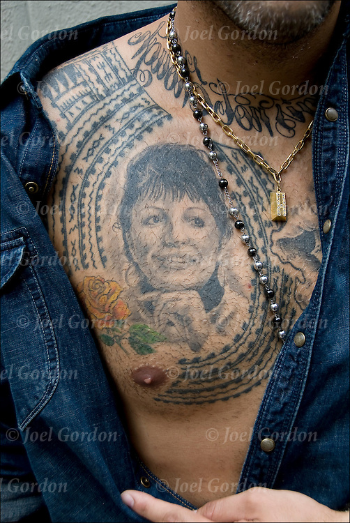 Outside of the NY Tattoo Convention @ Roseland Ballroom, 239 W 52nd Street, NYC. <br /> <br /> Tito &quot;Portrait of Mother on chest she passed &amp; her name was Rosa, and yellow roses were favorite and the Tautau  Tat around it means she rests in peace  &quot;Starlight tattoo&quot;.<br /> <br /> Body art or tattoos has entered the mainstream it is known longer considered a weird kind of subculture.<br /> <br /> &quot;According to a 2006 Pew survey, 40% of Americans between the ages of 26 and 40 have been tattooed&quot;.