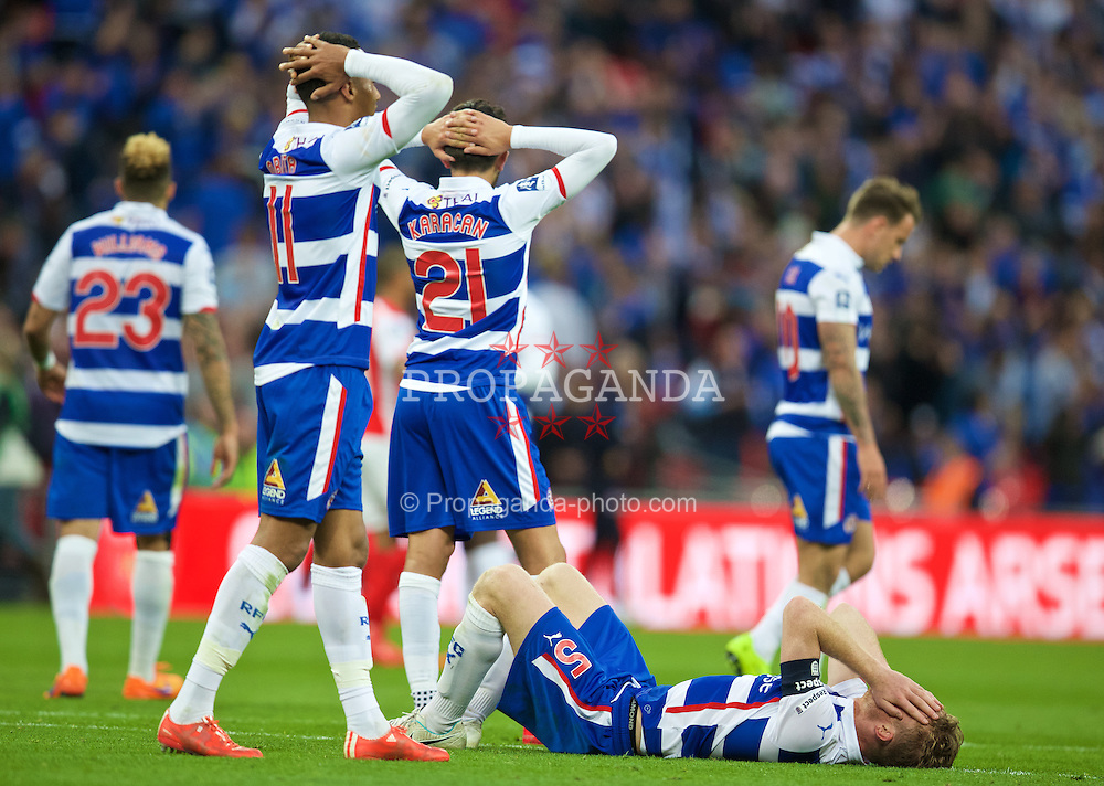 LONDON, ENGLAND - Saturday, April 18, 2015: Reading's captain Alex Pearce looks dejected after losing 2-1 to Arsenal in extra time of the FA Cup Semi-Final match at Wembley Stadium. (Pic by David Rawcliffe/Propaganda)