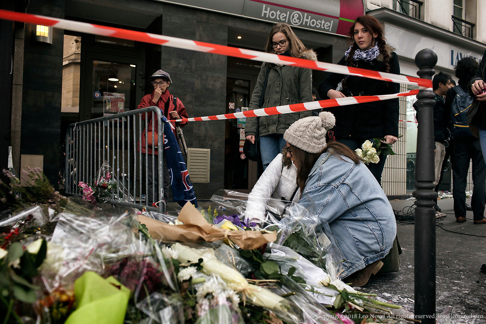 16  November  2015 – Paris, France Mourners lay flowers and light candles in front of a bar in central Paris where people were gunned down.  In a series of acts of violence, some 129 people were killing in shootings and suicide bombing. ISIL or islamic state claimed the responsibility.