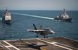 "PACIFIC OCEAN (May 3, 2017) An F/A-18E Super Hornet from the ""Kestrels"" of Strike Fighter Squadron (VFA) 137 lands on the flight deck of the Nimitz-class aircraft carrier USS Carl Vinson (CVN 70) as the Ticonderoga-class guided-missile cruiser USS Lake Champlain (CG 57), left, and the Arleigh Burke-class guided-missile destroyer USS Wayne E. Meyer (DDG 108) transit the western Pacific Ocean. The U.S. Navy has patrolled the Indo-Asia-Pacific routinely for more than 70 years promoting regional peace and security. (U.S. Navy photo by Mass Communication Specialist 2nd Class Z.A. Landers/Released)170503-N-GD109-147 <br />