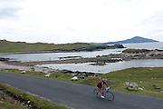 Cycling along Atlantic Drive, Achill Island, County Mayo, Ireland.