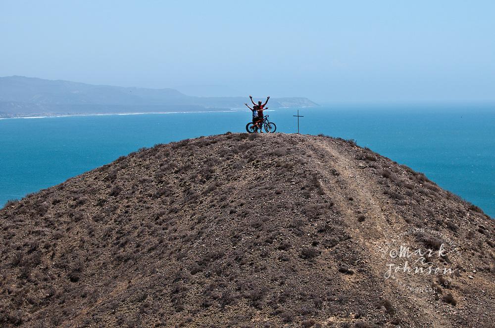 Couple mountain biking at Punto San Carlos, Baja California, Mexico