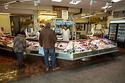 Ashton's fishmonger stall inside the market in city centre of Cardiff, South Wales, UK