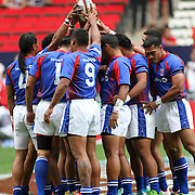 American Samoa's Talavalu comes together midfield at the 2014 Hong Kong Sevens for their first ever major international IRB 7's game.  Italy prevailed 31-12.  Photo by Barry Markowitz, 3/28/14, 3:06pm
