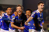 Korey Smith of Oldham Athletic (2nd left) celebrates scoring his first goal of the game to make it 1-1 during the Sky Bet League 1 match at the Matchroom Stadium, London<br /> Picture by David Horn/Focus Images Ltd +44 7545 970036<br /> 25/03/2014