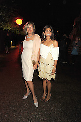 Left to right, VIMLA LALVANI and her daughter DIVIA CADBURY at the annual Serpentine Gallery Summer Party in Kensington Gardens, London on 9th September 2008.